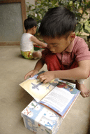 Child reading gospel tract from Operation Christmas Child